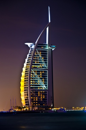 recognized: DUBAI - JANUARY 4: Burj al Arab hotel, one of the few 7 stars hotel in the world and one of the most recognized luxury symbol at night on JANUARY 4, 2012 in Dubai, United Arab Emirates