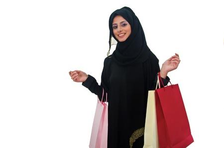 compras compulsivas: Hermosa mujer �rabe tradicional la celebraci�n de bolsas de la compra