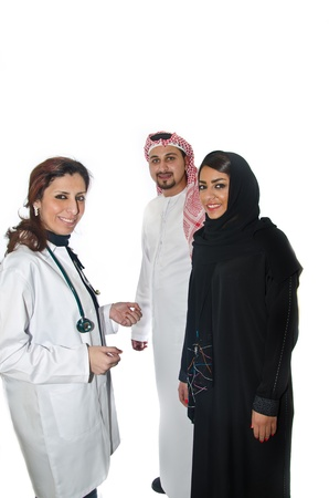 family medicine: Doctor with Arab Couple Stock Photo