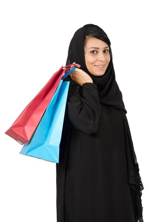 Arabv female carrying shopping bags photo