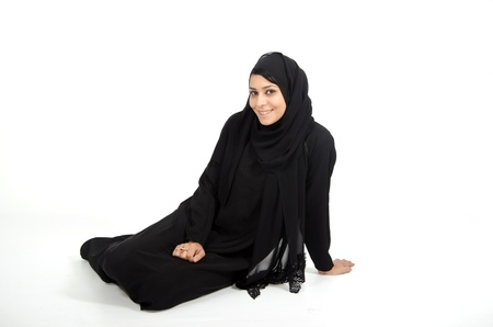 Arab female sitting on white background photo