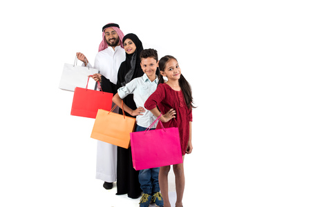 indexing: Arab family shopping and standing in raw Stock Photo