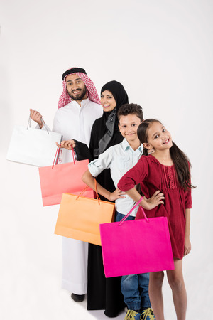 Arab family shopping and standing in raw Stock Photo