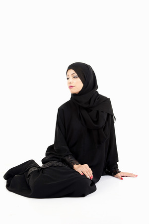 indexing: Arab woman Sitting on the floor isolated on white background