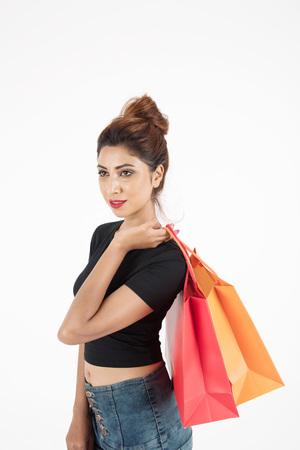 atractive: Beautiful atractive girl shopping on white background Stock Photo