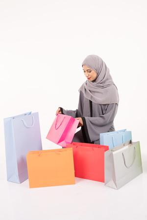 Beatuful Arab female shopping on white background Stock Photo