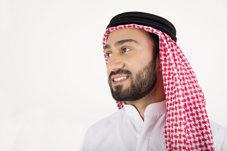 Young Arab man on white background Stock Photo