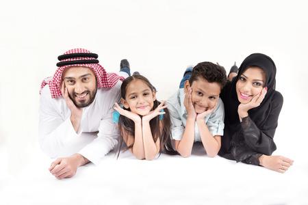 白い背景のアラブのイスラム教徒の家族 写真素材
