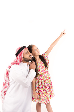 Arab father with his daughter indexing Stock Photo