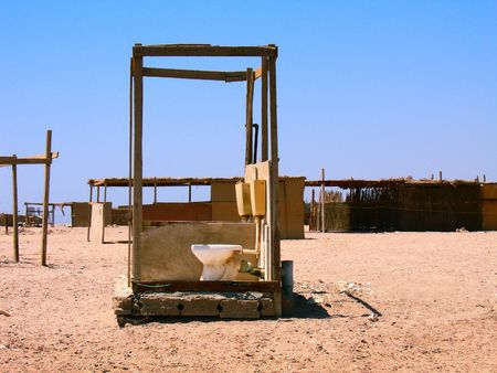 dirty room: Funny toilet sink standing alone in the desert