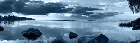 Panorama of a beautiful lake with clouds