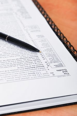 federal tax return: Tax form paper with a pen on it