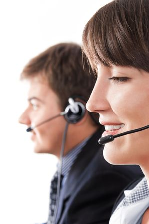 helpdesk: Friendly helpdesk operators over a white background Stock Photo