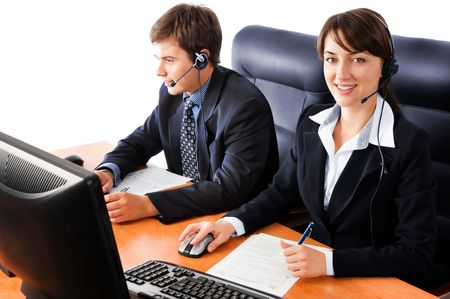 Friendly customer support team working at the office, against a white background Stock Photo - 5287748