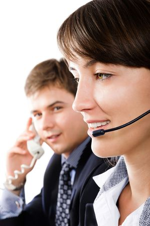 Friendly customer representatives smiling during a telephone conversation