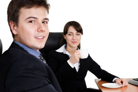 Business team at a coffee break looking at camera photo