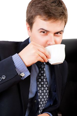 Businessman drinking coffee and looking at the camera photo