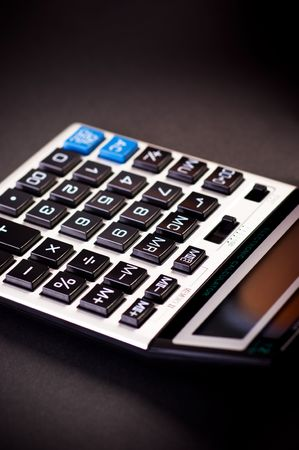Close-up image of a calculator on a black background