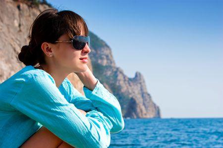 Pretty girl dreaming near the ocean