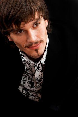 Portrait of handsome young adult against black background Archivio Fotografico