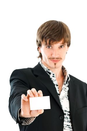 Stylish business man handing a blank business card over white background photo