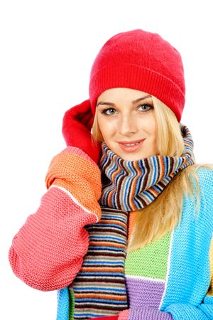 Photo of a young woman in colored sweater, gloves, touching her head with right hand against white background Archivio Fotografico
