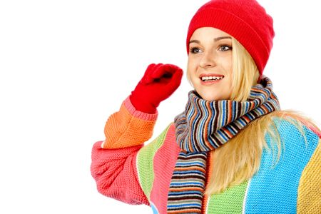 Photo of an attractive girl wearing winter clothes waving her hand to somebody against white background