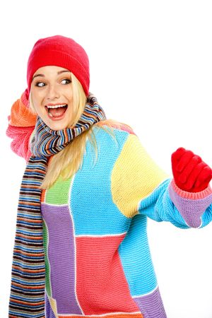 Photo of a young woman in winter clothes having fun against white background