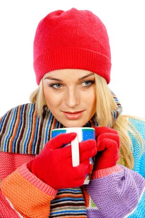 Beautiful young woman wearing winter clothes holding a cup of hot drink Archivio Fotografico