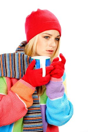 Cute girl in winter clothes with cup of hot drink looking for someone Archivio Fotografico