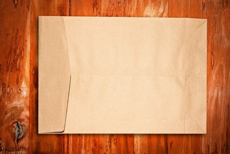 Brown paper Envelope on grung wood wall photo
