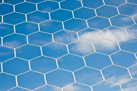 Soccer net and blue sky Stock Photo