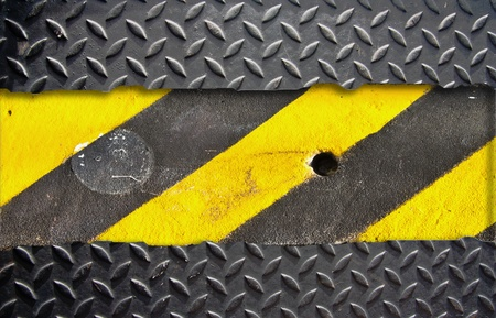 Metal plate pattern with warning strip.  photo