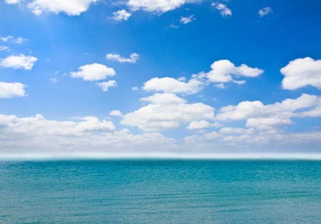 Cloudy blue sky over the sea photo