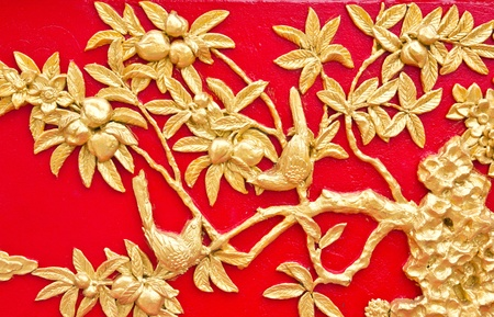 tree carved gold paint Texture on temple door  photo