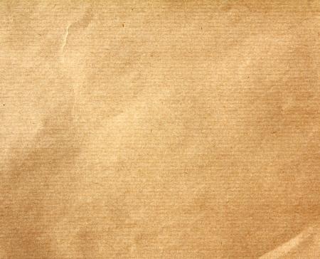 茶色の時代遅れの包装用紙の背景のテクスチャ
