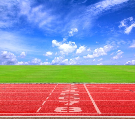 lane lines: Start or finish position on running track with blue sky2