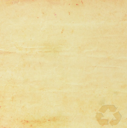 Recycle symbol on old grunge paper  photo