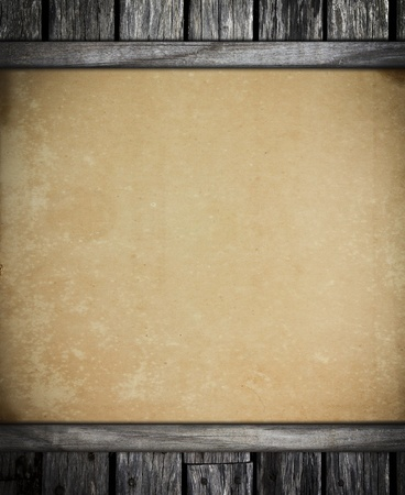 antiqued: old vintage paper on old wooden background