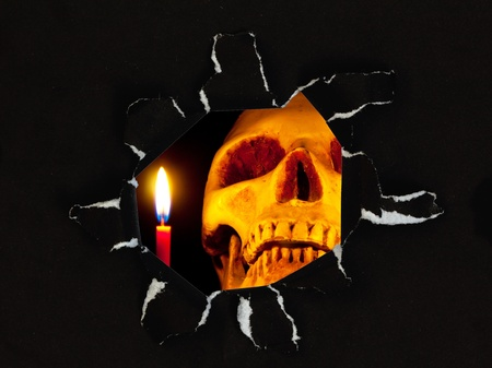 scary skull in Black paper hole, Halloween concept2 Stock Photo - 10417263