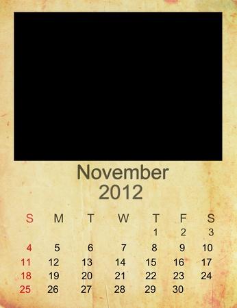 Calendar 2012, November on   Empty old photo frame.  Stock Photo