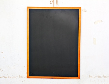 Emypy Chockboard on grunge white wall background