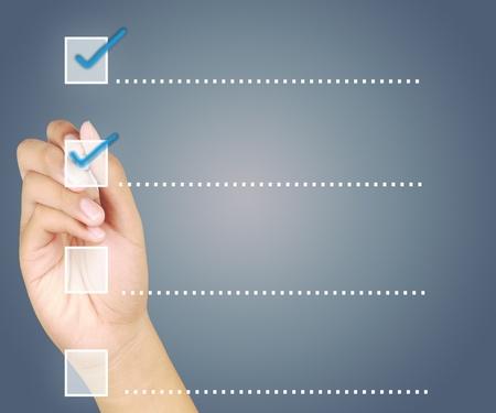 Hand check mark on a touchscreen button photo