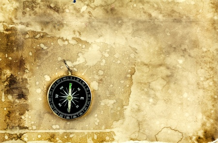 Compass on old vintage grunge paper background photo