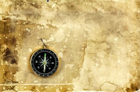 bygone: Compass on old vintage grunge paper background