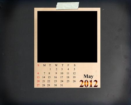 Calendar 2012 May, Blank photo frame on Blackboard Background Stock Photo - 11030488