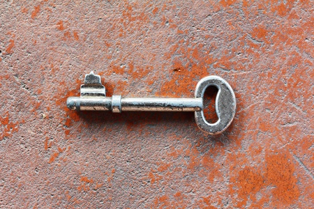 Vintage key on grunge wall photo