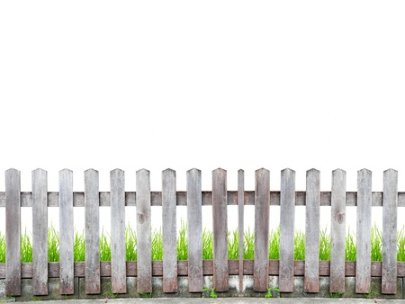 picket fence: old wood fence with green grass on white background Stock Photo