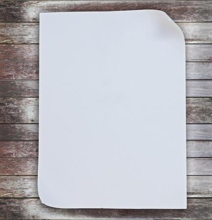 White paper on grunge wood panels background photo