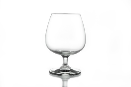 intoxicant: Empty brandy glass on white background
